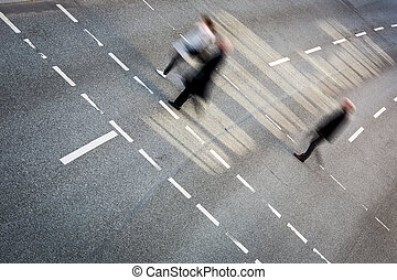 City business people crossing a street
