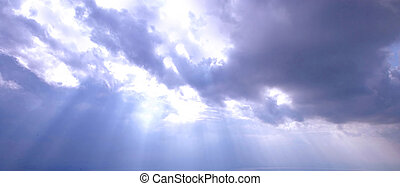 sun beam - darck sky with sun coming through the cloud - sun...
