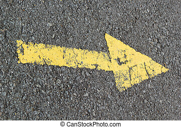 Yellow arrow on the road