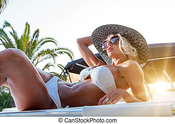 Young woman on her private yacht - Young sexy woman on her...