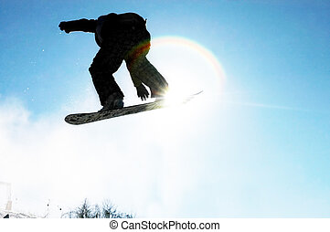 Snowboard 1 - A snowboarder going big high above the half...