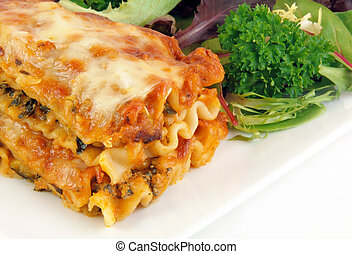 Lasagna With Salad - Close up image of spinach lasagna with...
