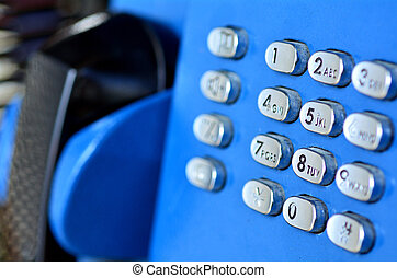 Public pay telephone - Close-up view of an aging pay...