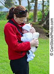 Mother carry newborn baby on baby carrier. concept photo of...