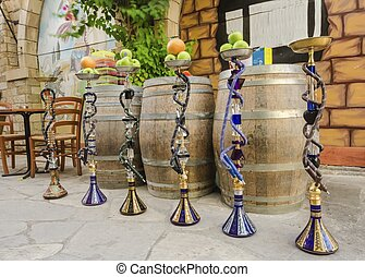 Shisha with fruit - Six shisha, aka nargile or hookah at a...