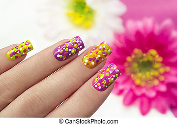 Dots. - Colour nail Polish are covered with...