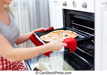 Cooking pizza