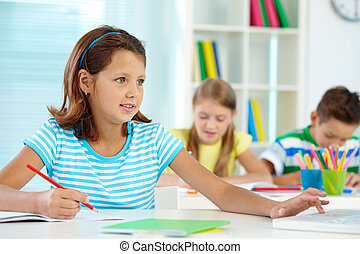 Schoolgirl at lesson - Portrait of cute girl working at...
