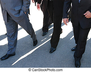 business people going - businessmen on their way to the...