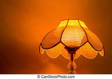 Lighting home lamp besides stucco wall
