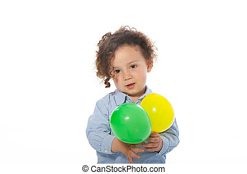 Adorable little boy holding two balloons, on white -...