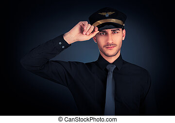 Pilot Salute Low Key Portrait - Young pilot wearing black...