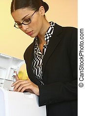using Xerox ljkl - Pretty young businesswoman using Xerox...