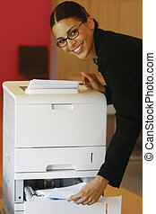 using Xerox lool - Pretty young businesswoman using Xerox...