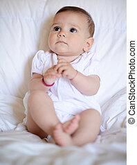 Beautiful baby girl looking at camera