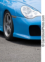 Sports Car Fender - A closeup of the custom rims and...