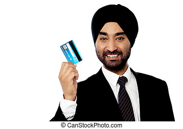 Happy male executive holding credit card - Young smiling...
