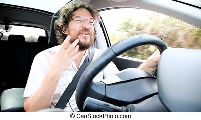 Cool man laughing and driving