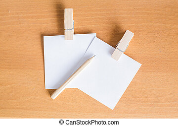 Paper note with clip on wooden floor Background