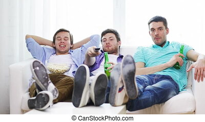male friends with beer watching tv at home - friendship,...