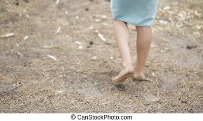 Baby in towel - Wrapped in towel child walks barefoot forest