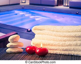 Spa massage border background with towel stacked,red candles...
