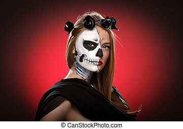 Young woman in day of the dead mask skull face art....