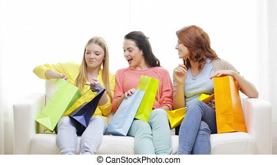 smiling teenage girls with many shopping bags - shopping,...