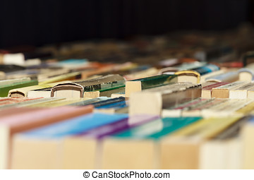 Old books for sale - Colorful old books lined up for sale in...