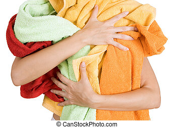 Woman holding a lot of colorful laundry in her hands,...