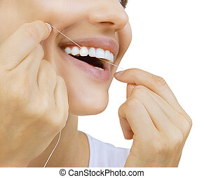 Woman and teeth floss - Young caucasian woman flossing her...