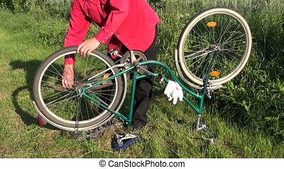 repair retro bicycle on farm garden grass