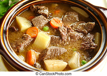 Beef Stew - Rich hearty beef stew simmering and ready to...