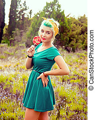 creative girl with a bright lollipop
