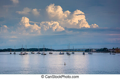 Storm clouds over boats in the Matanzas River, in St....