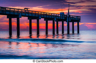 The fishing pier at sunrise, in St. Augustine Beach,...