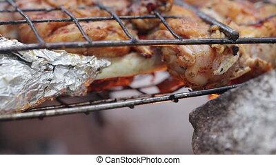 Chicken legs on open fire