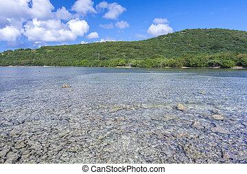 Topical bay - Shallow rocky bay of Bahia LInda on beautiful...