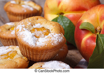 delicious cupcakes with peach sprinkled with powdered sugar...