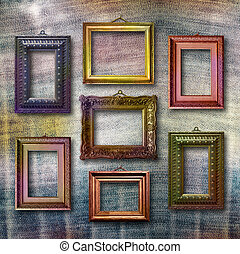 Gilded wooden frames for pictures on blue jeans background