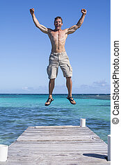Hooray - Lean muscular shirtless Caucasian man jumps...
