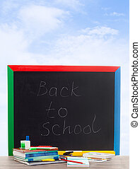 school board on a background of blue sky with clouds