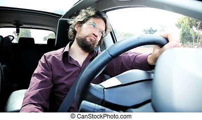 Man in car angry stock in traffic - Man late for job...