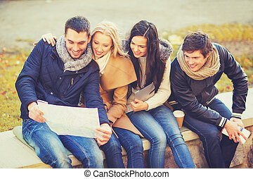 couples with tourist map in autumn park - holidays and...