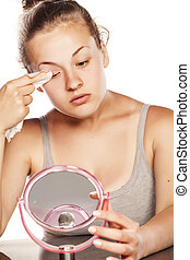 make up removing - young blonde removes her makeup with a...