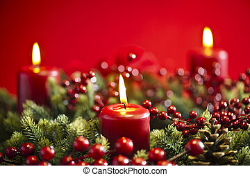 Advent wreath over red background with winter rose and...
