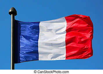 Flag of France, waving in the wind, on the blue sky