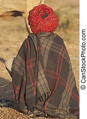 Rajasthani Cattle Herder - Rajasthani man with bright red...