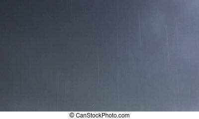 Rain on dark clouds background.
