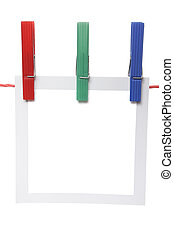 Photo hanging - Photo paper on a clothesline with three...